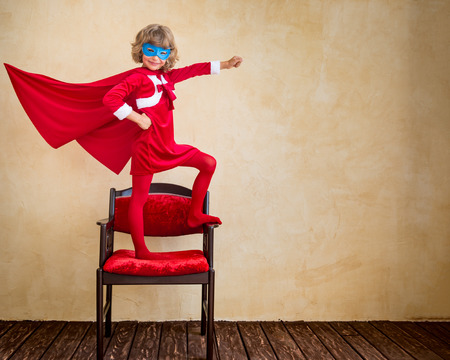 47426673 - superhero kid at home. christmas holiday concept