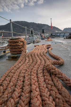 93789758 - thick ropes on a deck of navy ships in the port of bergen